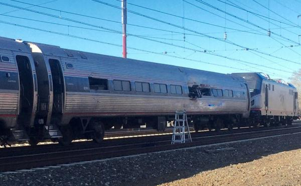 Amtrak said the train was heading from New York to Savannah, Ga., on Sunday when it struck a backhoe outside  Philadelphia.