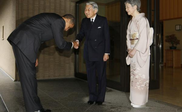 President Obama bows as he greets Japanese Emperor Akihito and Empress Michiko at the Imperial Palace in Tokyo in 2009. The president travels to Japan next month and there's speculation he might visit Hiroshima, the site of the world's first atomic bombin