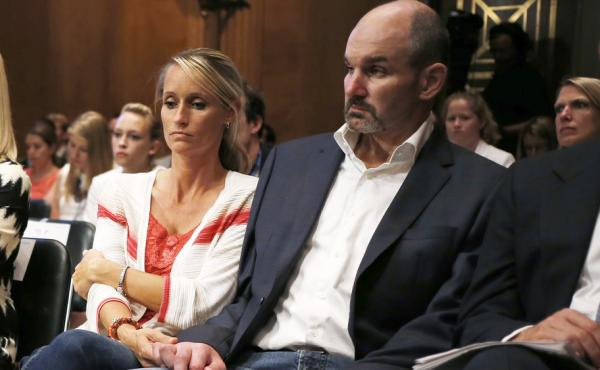 Kevin Turner was a lead plaintiff in the class-action lawsuit against the NFL that was affirmed Monday. Turner died last month; he's seen here in a 2014 Senate hearing on the long-term effects of brain injuries.
