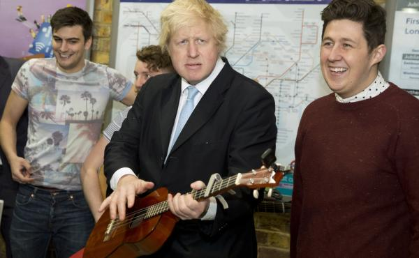 London Mayor Boris Johnson plays a guitar at an event to promote street performances in the city in March 2015. Johnson has broken ranks with Prime Minister David Cameron, a fellow Conservative Party member, by calling for Britain to leave the European Un
