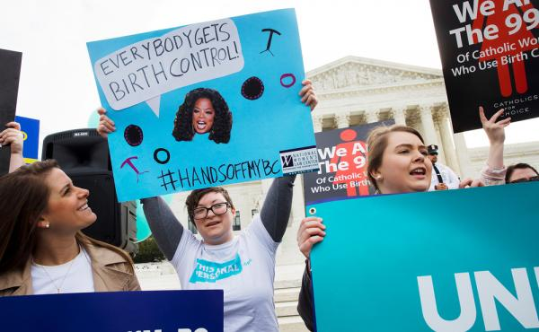 Supporters of insurance coverage for birth control rallied outside the U.S. Supreme Court in March.
