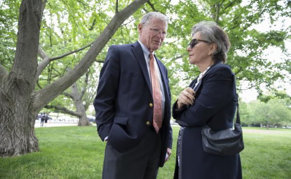 Environment and Public Works Committee Chairman Sen. James Inhofe, R-Okla., speaks with Sen. Barbara Boxer, D-Calif., on Thursday before joining a bipartisan group of senators at a Capitol Hill news conference to discuss legislation to improve the federal