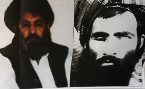Taliban leader Mullah Akhtar Mansour (L) and former leader Mullah Mohammad Omar, in Kabul, Afghanistan in a Aug. 1, 2015 file photo. Mansour is believed to have been killed in a U.S., airstrike.