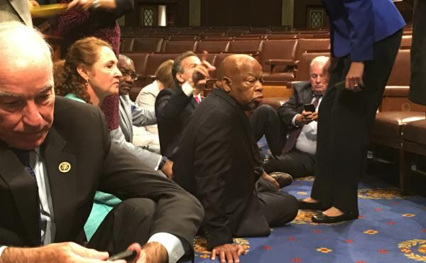 This photo provided by Rep. John Yarmuth, D-Ky., shows Democrat members of Congress, including Rep. John Lewis, D-Ga., (center) and Rep. Joe Courtney, D-Conn., (left) participating in a sit-down protest seeking a vote on gun control measures, Wednesday on