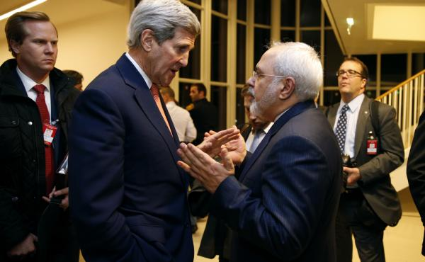 Secretary of State John Kerry talks with Iranian Foreign Minister Mohammad Javad Zarif in Vienna on Jan. 16, after the International Atomic Energy Agency verified that Iran met all conditions under the nuclear deal. The accord is now one-year-old. Iran is