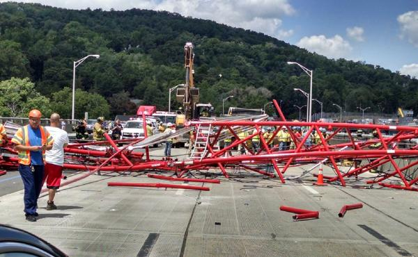A giant crane sits on the roadbed of the Tappan Zee Bridge north of New York City after toppling around noon on Tuesday, during construction of a new bridge.