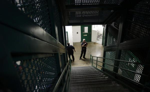 Guards watch over a single cell area in an acute unit of the mental heath unit at the Harris County Jail in Houston in 2014.