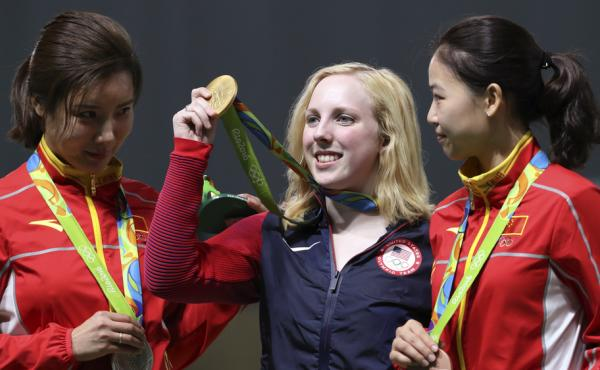 Ginny Thrasher (center) of the U.S. holds her gold medal for the women's 10-meter air rifle competition, the first gold awarded at the Rio Games. China's Du Li (left), won the silver and Yi Siling, also of China, won the bronze on Saturday.