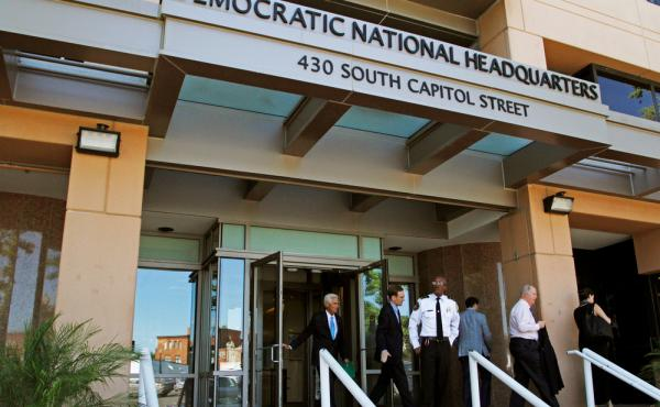 People stand outside the Democratic National Committee headquarters in Washington, D.C., in June. DNC staffers said publication of leaked emails in July was a Russian ploy to support the candidacy of Donald Trump. But, says a Russian investigative journal