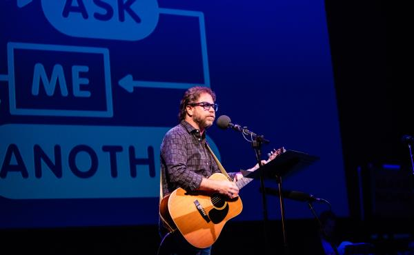 Ask Me Another's house musician Jonathan Coulton leads a music parody game at the Paramount Theatre in Austin, Texas.