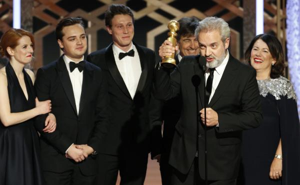 Sam Mendes accepts the award for best drama movie for 1917 at the Golden Globes on Sunday night.