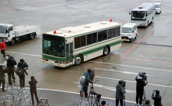 A bus believed to be carrying former U.S. special forces member Michael Taylor and his son Peter, who allegedly staged the operation to help fly former Nissan chief Carlos Ghosn out of Japan in 2019, leaves Narita International Airport in Japan on Tuesday