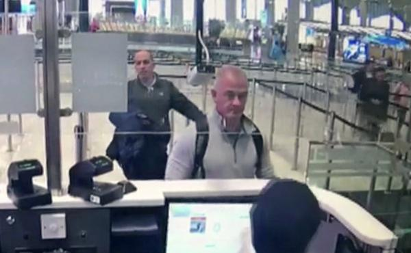 This Dec. 30, 2019 image from security camera video shows Michael L. Taylor, center, and George-Antoine Zayek at passport control at Istanbul Airport in Turkey. Taylor and his son Peter, are charged in Japan with helping Nissan's former chairman, Carlos G