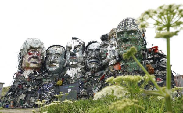 A sculpture created out of electronic waste in the likeness of Mount Rushmore and the G-7 leaders sits on a hill in Cornwall, England, near where the leaders of the world's wealthiest nations will meet.