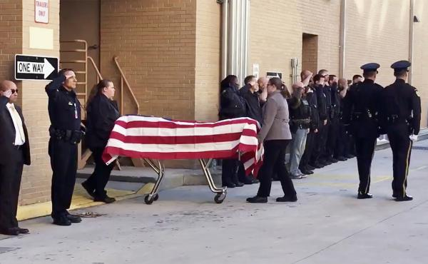 Officers salute Master Sgt. Debra Clayton on Monday in Orlando, Fla.