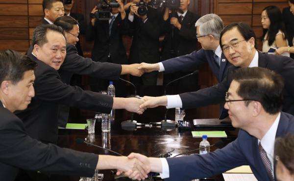North Korea and South Korea will hold their third high-level summit in September. The meetings were agreed to at  a meeting of South Korean Unification Minister Cho Myoung-Gyon, second from right, who shook hands with his North Korean counterpart Ri Son G