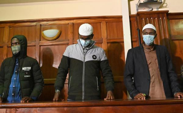 Suspects (left to right) Hassan Hussein Mustafa, Liban Abdullahi Omar, and Mohamed Ahmed Abdi standing in the dock during their appearance for their case at the Milimani court in Nairobi on Wednesday. Abdi and Mustafa were found guilty, while Omar was acq