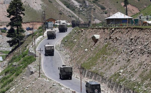 An Indian army convoy moves along Srinagar-Leh national highway Monday at Gagangeer, in east Kashmir's Ganderbal district.