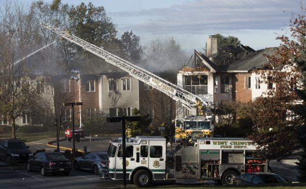 Firefighters worked on Friday to put out the smoldering fire that blazed across the rooftops of the Barclay Friends Senior Living Community in West Chester, Pa., the previous night.