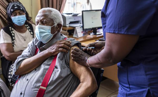 An older person receives their first dose of the AstraZeneca vaccine in Thika, Kenya. The vaccine's manufacturer, Serum Institute of India, announced this week that it will freeze all exports of the vaccine through the end of this year — leaving 20 mill