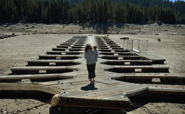 Marina owner Mitzi Richards carries her granddaughter in September as they walk on their boat dock at the dried up lake bed of Huntington Lake in California, which was at only 30 percent capacity as a severe drought continued. The state was in the grip of