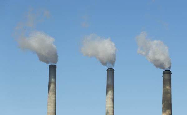 Emissions rise from three large smokestacks at a coal-fired power plant in Castle Dale, Utah, in 2017. Democratic presidential candidates are releasing plans to reduce U.S. emissions in order to head off the most dangerous consequences of global warming.