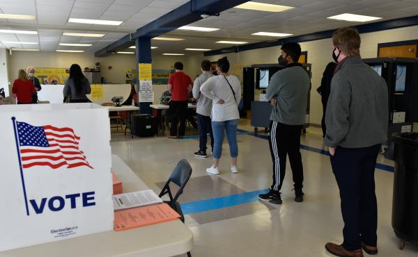 Georgia voters at an Atlanta polling place during the January runoff elections for two U.S. Senate seats. Election officials in the state say new laws and disinformation have made their jobs difficult.