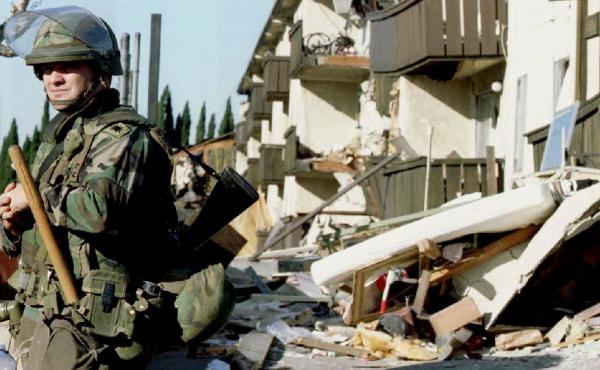 A National Guardsman stands guard outside the ruins of the Northridge Meadows Apartments where 16 people died during the  January 1994 earthquake that rocked Southern California. Since then, many of these kinds of apartments have been retrofitted to withs