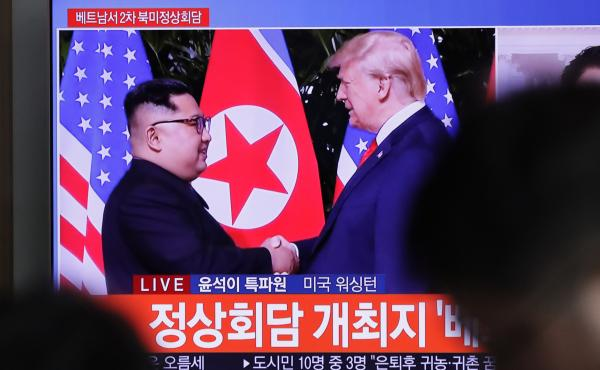 A TV screen shows file footage of President Trump and North Korean leader Kim Jong Un during a news program seen at the Seoul Railway Station in Seoul, South Korea, Wednesday. During Trump's State of the Union address, he announced that the second summit