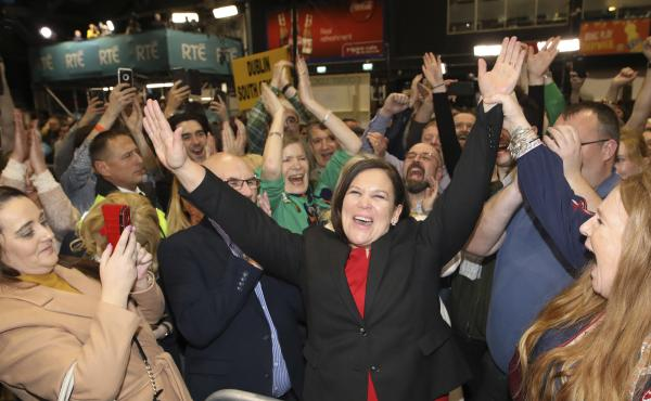 Sinn Fein leader Mary Lou McDonald (dressed in red and black) celebrates with party supporters Sunday after receiving poll results in Dublin.