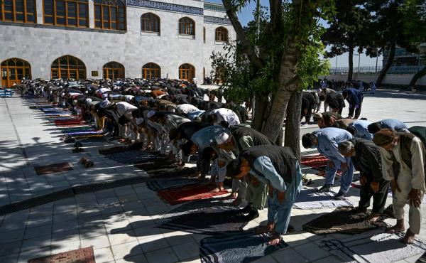 Muslim worshipers in Kabul offer prayers Sunday at the start of Eid al-Fitr, which marks the end of the Muslim holy month of Ramadan. The Taliban announced a three-day ceasefire during the holiday, a surprising move after months of bloody fighting.