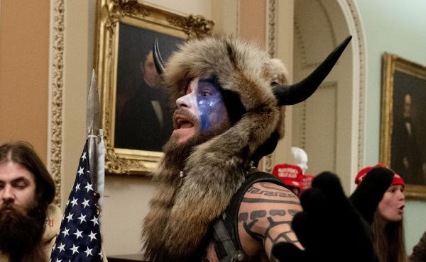 """The Justice Department announced Saturday that it had charged the man known as the """"QAnon shaman,"""" Jacob Anthony Chansley in connection with the Capitol break-in on Wednesday."""