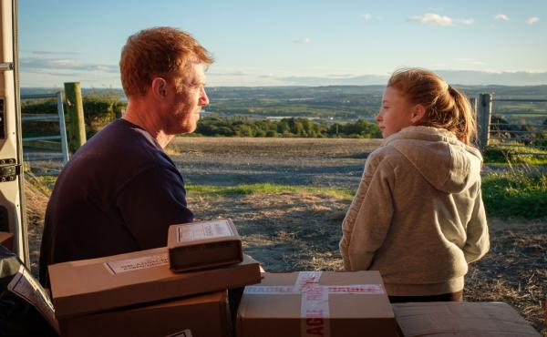 Delivery van driver Ricky (Kris Hitchen) takes a break with his his daughter (Katie Proctor) in the Ken Loach drama Sorry We Missed You.
