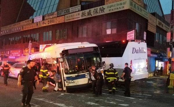 NYPD officers respond to a deadly crash involving two buses in the New York City borough of Queens on Monday.