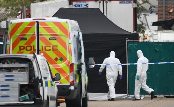A police forensic investigation team walks near the site where 39 bodies were discovered in the back of a truck on Wednesday in Waterglade Industrial Park in Grays, England. Police believe the truck is from Bulgaria, a member of the European Union, and th