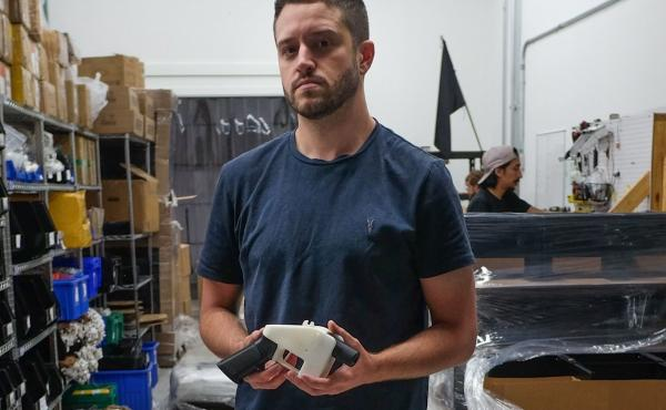 """Cody Wilson, owner of Defense Distributed, holds a 3D printed gun, called the """"Liberator,"""" in his factory in Austin, Texas, in August. The 30-year-old has been accused of sexually assaulting a minor."""