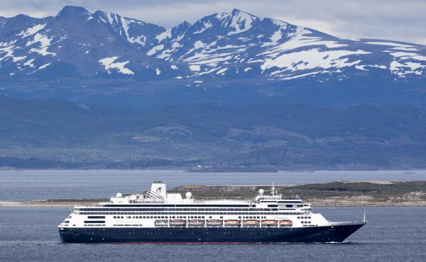 The Holland America cruise ship Zaandam sails past snow-capped mountains in Patagonia, Argentina.