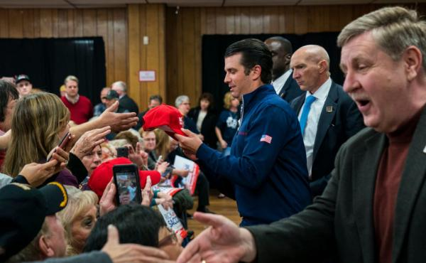 Donald Trump Jr. and Rick Saccone, GOP nominee for Pennsylvania's 18th district, shake hands with supporters during a campaign rally on Monday.