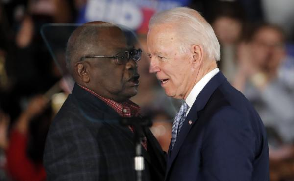 Rep. Jim Clyburn of South Carolina talks with former Vice President Joe Biden at Biden's Democratic presidential primary rally in Columbia, S.C., on Saturday.