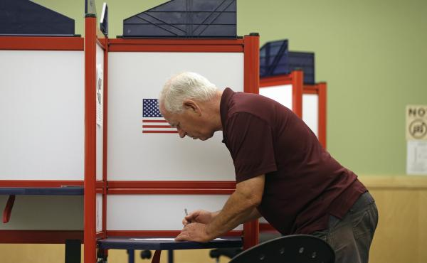 Rick Colyer votes at the Durham County Library North Regional in Durham, N.C., Tuesday.