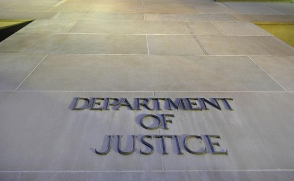 The Department of Justice headquarters building in Washington photographed early in the morning.