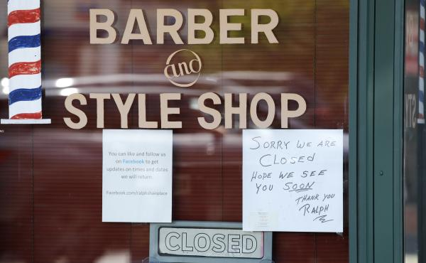 A Seattle barbershop remains closed because of the coronavirus outbreak on May 19. Last week, an additional 2.1 million people filed for unemployment benefits around the country.