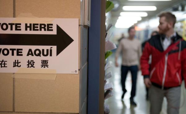 People exit the building after voting at Public School 321 in Brooklyn on Tuesday.