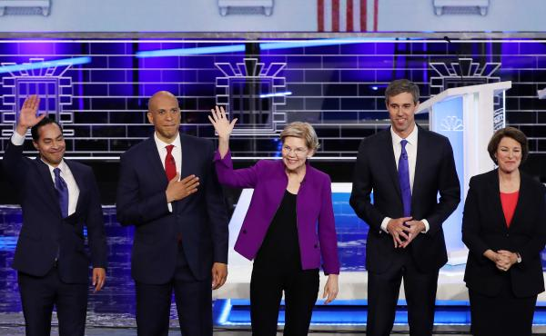 On Wednesday in Miami, Democratic presidential candidates take the stage during the first night of the Democratic presidential debate. From left: former Housing and Urban Development Secretary Julián Castro, New Jersey Sen. Cory Booker, Massachusetts Sen