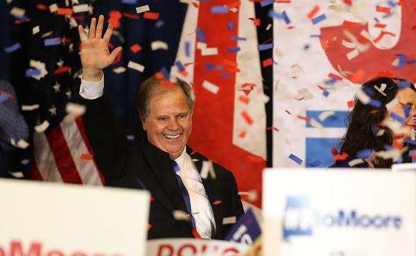 Democrat Doug Jones greets supporters before his victory speech Tuesday night. Jones defeated controversial Republican Roy Moore to become the first Democratic senator elected from Alabama in 25 years.