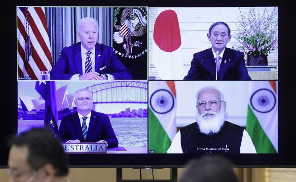 The last Quad meeting, in March, was virtual. President Biden, Yoshihide Suga, Japan's prime minister (top right), Scott Morrison, Australia's prime minister (bottom left), and Narendra Modi, India's prime minister, will meet in person in the U.S. on Frid