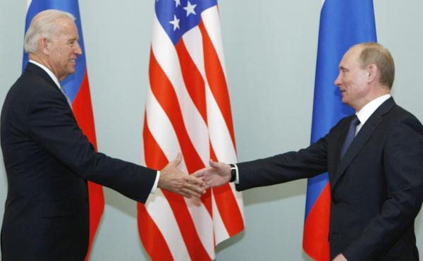 In this 2011 photo, Joe Biden, then vice president, shakes hands with Vladimir Putin, then Russia's prime minister, in Moscow. President Biden will hold a summit with Putin this week in Geneva, a face-to-face meeting between the two leaders that comes ami