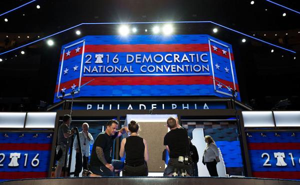 Workers prepare the podium Sunday ahead of the Democratic National Convention at the Wells Fargo Center in Philadelphia.