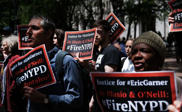 Protesters gathered outside of Police Headquarters in Manhattan in May during the police disciplinary hearing for Officer Daniel Pantaleo, who has been accused of using a chokehold that led to Eric Garner's death in 2014.