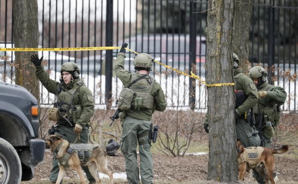Police respond to reports of an active shooting at the Molson Coors Beverage Co. campus in Milwaukee on Wednesday.
